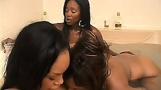 Three Sensual Black Sluts Have Some Fun With A Strap-On In The Jacuzzi