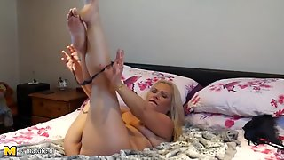 Mom In A Thong Fondles Her Tits And Masturbates