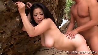 Gleaming Japanese Cowgirl Getting Drilled Doggystyle At The Beach