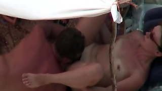 Hubby Eats Out Hairy Pussy On The Beach