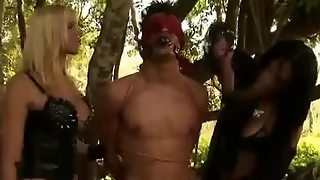 Guy Dominated By Trannies In The Forest