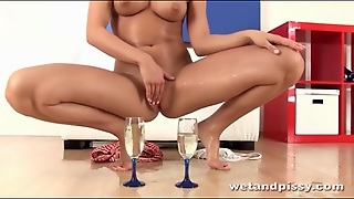 Shaved Girl Pees In A Champagne Glass