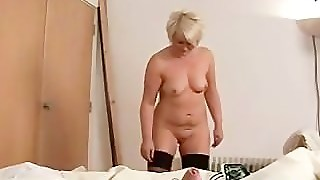 Angry Blonde In Stockings Gives Guy A Harsh Handjob