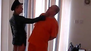 Dominant Leather Clad Mistress Spanks Prisoner Slaves Ass With Her Whip