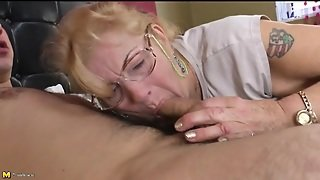 Granny In Glasses Gives A Sexy Blowjob