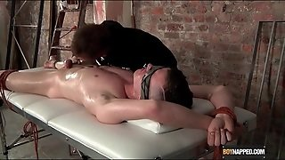 Bound Boy On His Back Getting A Handjob