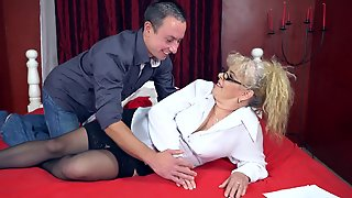 Granny Gets A Facial Cumshot From The Young Man