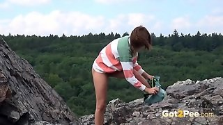 Hiking Girl Pees On The Boulder Beneath Her