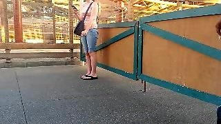 Voyeur Smoking At Theme Park