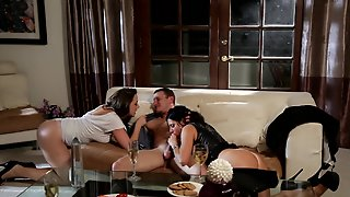 Two Women Are With A Man On The Sofa, Having A Sexy Threesome