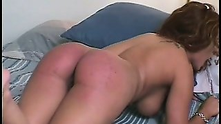 Blonde Mistress Is Very Distressed With Her Redheaded Slave And Gives Her A Spanking