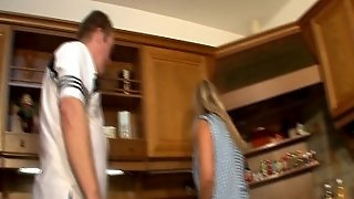 Mature Blonde Cooks In The Kitchen