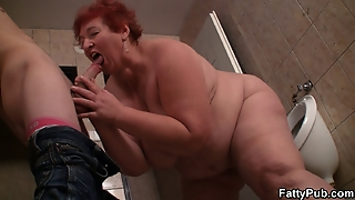 Huge Bitch Takes It From Behind In The Public Restroom