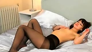 Brunette Student Masturbating On The Bed