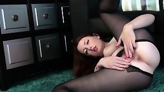 Redhead In Black Pantyhose