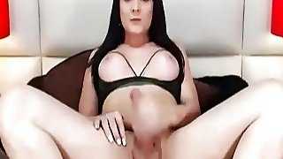 Busty Shemale Babe Jerks Her Huge Cock