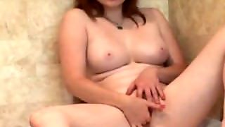Red Head Finger Fucks Her Pussy In Shower