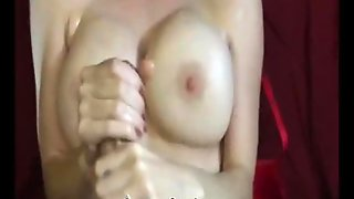 Woman With Big Boobs Does A Handjob