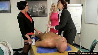 Group Of Femdoms In The Office Giving A Handjob