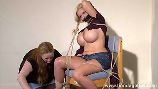 Lesbian Bondage Of Melanie Moon In Tape Gagged Submission
