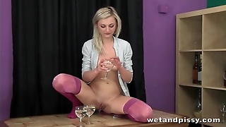 Blonde Pees In Wine Glasses And Pours It