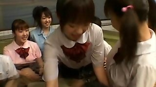 Hot Japanese Chicks Massaging Two Studs