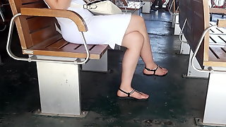 Dangling Long Sexy Crossed Feets In Sandals