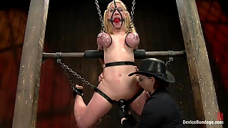 Busty Blond In Latex Enjoys Some Breast Bondage