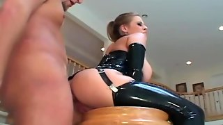 Busty Blonde In Latex Stockings And A Corset
