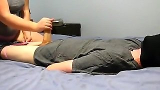 Blindfolded And Tied Up Guy Gets A Handjob From His Chubby Gf On The Bed