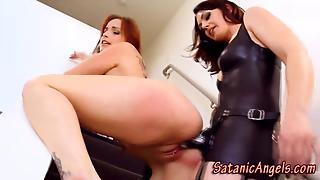 Lesbian Dominates Pussy With Strapon