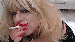 Smoking Transvestite With Red Lipstick