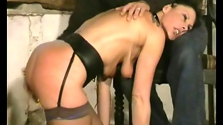 Dungeon Babe In Corset Licks His Boots