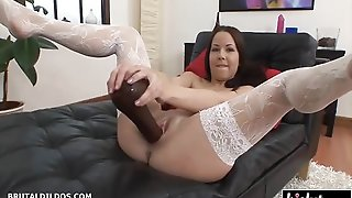 Sexy Honey In Stockings Uses A Dildo