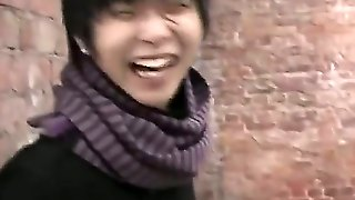 Asian Fellow Seduces His Pretty And Naughty Girlfriend To Suck His Dick Outdoor, Right On A Street During The Winter. She Lowers His Pants And Starts Playing With His Fat Rod.