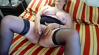 Mature Chubby Dildoing On Bed