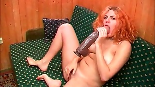 Cute Redhead Pleasures Hole With Huge Toy