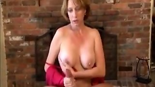 Mature Hand Breast And Blow Job