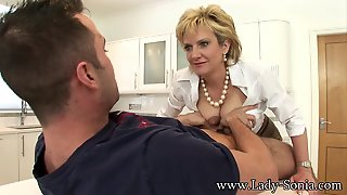 Lady Sonia Jerks Off Young Stud On Kitchen Coun
