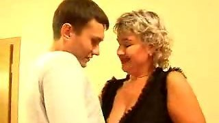 Russian Lady In Stockings With Young Man