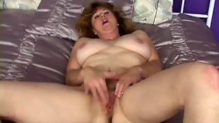 Mom On Her Satin Sheets Rubbing Her Wet Cunt