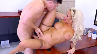 A Hot Blonde With Large Boobs Is On The Desk, Getting Fucked