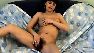 She Rubs A Very Hairy Pussy