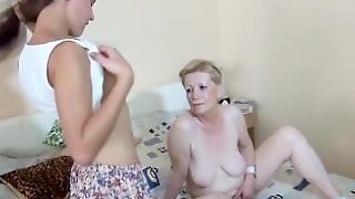 Old Lady And Young Woman Striptease And Toy Playing