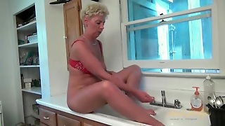 Granny Gives Up Washing Dishes To Masturbate