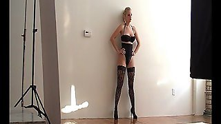 A Big Titted Blonde In High Heels, Stockings And Lingerie