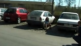 Teen Peeing Behind The Cars