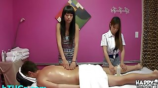 Hot Tug Job In A Massage Room From Two Young Asian Babes Stroking Cock