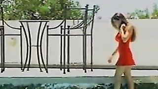 Milf With A Cock Outdoors By A Pool