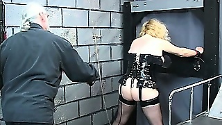 Freaky Blonde Bitch In A Corset Puts Herself Up For A Flogging
